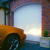 Insulated roller garage door in white fitted to an arched garage