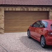 Insulated roller garage door in golden oak