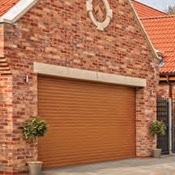 Insulated roller garage doors in golden oak