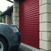 Insulated roller garage door in burgundy – park right up to the door!