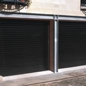Twin insulated roller garage door